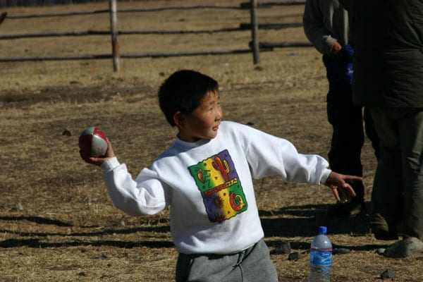 A Mongolian boy at a remote homestead just outside Ulaan Baataar in Mongolia with a Tanner De Witt rugby ball.