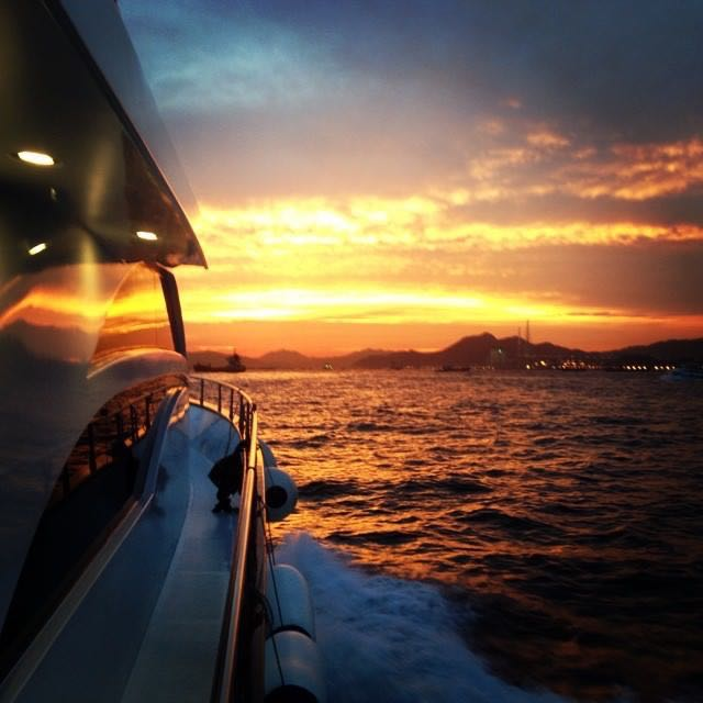Sunset on board the yacht on the way to Lamma Island for seafood dinner