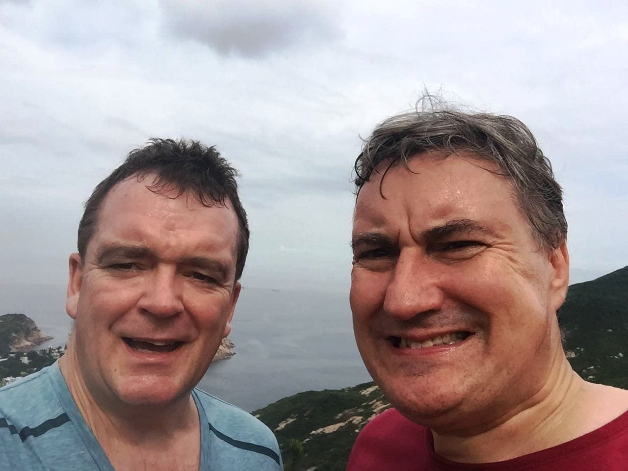 FraudNet members Jeff Lane and Stephen Baker enjoying a very hot hike along Dragon's Back on Hong Kong Island