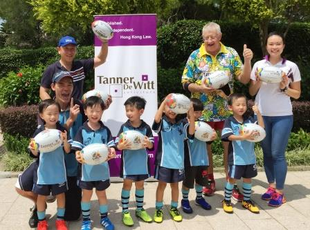 Jim Leung (Chairman of the Minis), Mark Side and Natalie Lam with the Hong Kong Monkeys and their coach