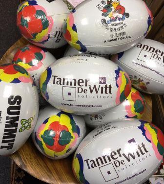 Tanner De Witt mini rugby balls
