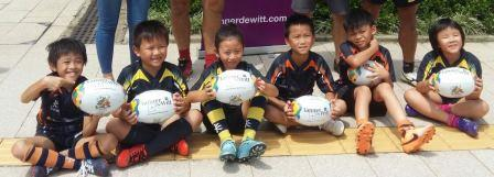 Mini Rugby Club members receive their balls